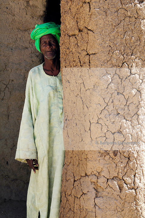 An elder in the mud mosque of his village: Moussoukourare in the Saharan region of Mali