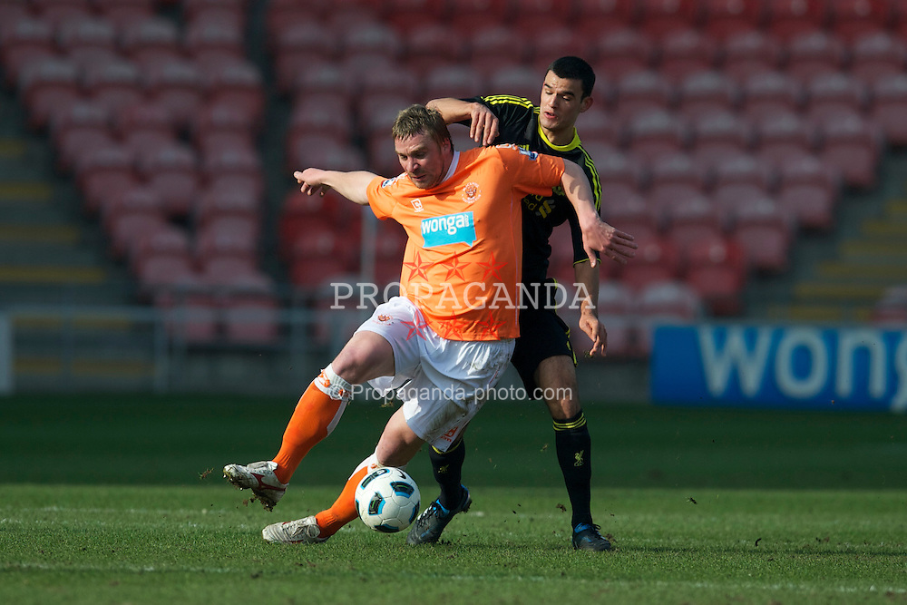 BLACKPOOL, ENGLAND - Wednesday, March 3, 2011: Liverpool's Conor Thomas and Blackpool's Sergey Kornilenko during the FA Premiership Reserves League (Northern Division) match at Bloomfield Road. (Photo by David Rawcliffe/Propaganda)