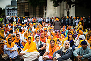 UNITED KINGDOM, London: 15 July 2015 Members of the Sikh Community block the road outside Parliament during a demonstration calling for the release of Sikh political prisoners in India, and for the British Government to cease it's support of the Indian Government in London, England. Andrew Cowie / Story Picture Agency