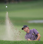 Sergio Garcia hits out of a sand trap on the 18th hole during a practice round at Baltusrol Golf Club Springfield, NJ Tuesday 9 August 2005.