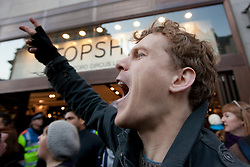 © Licensed to London News Pictures. 17/12/2011. LONDON, UK. A UK Uncut protester shouts outside Topshop's flagship store on Oxford Street in London today (17/12/11). Demonstrators had intended to hold a protest inside the shop, but the few that gained entry were ejected by security and police. Photo credit: Matt Cetti-Roberts/LNP