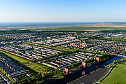 Nederland, Flevoland, Almere, 07-05-2018; Almere Buiten Oost, Regenboogbuurt, kleurrijke buurt. In de voorgrond de woontorens van Liesbeth van der Pol, De Rooie Donders.<br /> Rainbow neighbourhood, colorful neighborhood.<br /> <br /> luchtfoto (toeslag op standard tarieven);<br /> aerial photo (additional fee required);<br /> copyright foto/photo Siebe Swart