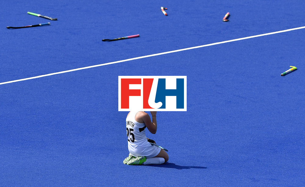 TOPSHOT - New Zealand's Kelsey Smith kneels on the pitch at the end of the women's Bronze medal hockey Germany vs New Zealand match of the Rio 2016 Olympics Games at the Olympic Hockey Centre in Rio de Janeiro on August 19, 2016. / AFP / Pascal GUYOT        (Photo credit should read PASCAL GUYOT/AFP/Getty Images)