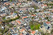 Nederland, Noord-Holland, gemeente Bergen, 20-04-2015; <br /> Parochiekerk Bergen (onder in beeld) en de bekende  Ruinekerk in het centrum van Bergen. Kunstenaarsdorp.<br /> Village famous for its painters, North Holland.<br /> luchtfoto (toeslag op standard tarieven);<br /> aerial photo (additional fee required);<br /> copyright foto/photo Siebe Swart