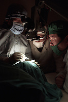 North Korea Eye Surgery Workshop. Opthlamoligist from Korea watches closely as Intra-occular lens is is placed into the eye of a patient by Dr Sanduk Ruit at the cataract workshop in Haeju.