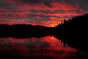 Sunset on the Vermilion River in Northern Ontario, Canada.