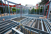 """On 3/5/2013 the steel framing continues to be assembled over the foundation on the Begley's new home. Steel, while not a common material for residential framing, is 94% recyclable, has been milled locally for this project, and is a more sustainable choice than wood, which is typically used for residential building construction. Ed Begley Jr. (noted actor and environmentalist) and his wife Rachelle Carson-Begley are building their new home under LEED Platinum Certified standards in an attempt to become North America's greenest, most sustainable home. It is also being filmed for their web series """"On Begley Street."""" Studio City, California, USA"""
