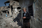 Kassim Hussein, 75, stands outside his home in the Old City, which was hit by an airstrike during the battle to retake the city of Mosul.