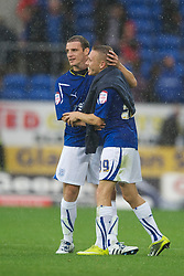 CARDIFF, ENGLAND - Saturday, August 21, 2010: Cardiff City's Craig Bellamy congratulates his former Wales team-mate Jason Koumas after his side's 4-0 victory over Doncaster Rovers during the Football League Championship match at the Cardiff City Stadium. (Pic by: David Rawcliffe/Propaganda)