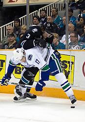 April 8, 2010; San Jose, CA, USA; Vancouver Canucks center Ryan Kesler (17) checks San Jose Sharks defenseman Douglas Murray (3) during the first period at HP Pavilion.  San Jose defeated Vancouver 4-2. Mandatory Credit: Jason O. Watson / US PRESSWIRE