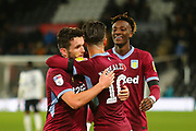 Aston Villa midfielder JohnMcGinn (7), Aston Villa's Tammy Abraham (18) and Aston Villa midfielder Jack Grealish (10) celebrate after the final whistle during the EFL Sky Bet Championship match between Derby County and Aston Villa at the Pride Park, Derby, England on 10 November 2018.