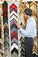 Young man browsing at a frame store