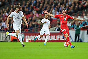 Switzerland's Josip Drmic is chased down by England's Gary Cahill during the UEFA European 2016 Qualifying match between England and Switzerland at Wembley Stadium, London, England on 8 September 2015. Photo by Shane Healey.