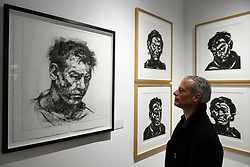 © Licensed to London News Pictures. 03/05/2017. London, UK. A visitor views portraits by Alison Lambert at the preview of the 32nd London Original Print Fair at the Royal Academy of Arts in Piccadilly.  51 international specialist dealers are presenting works in the print medium to buyers from 4 May to 7 May. Photo credit : Stephen Chung/LNP