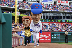 March 29, 2018 - Arlington, TX, U.S. - ARLINGTON, TX - MARCH 29: The Texas Rangers Legends mascot race caricature of Nolan Ryan races between innings during the game between the Texas Rangers and the Houston Astros on March 29, 2018 at Globe Life Park in Arlington, Texas. Houston defeats Texas 4-1. (Photo by Matthew Pearce/Icon Sportswire) (Credit Image: © Matthew Pearce/Icon SMI via ZUMA Press)