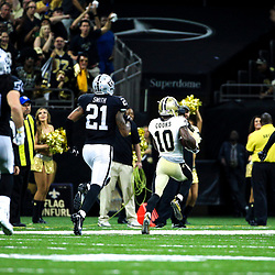 Sep 11, 2016; New Orleans, LA, USA;  New Orleans Saints wide receiver Brandin Cooks (10) runs past Oakland Raiders defensive back Reggie Nelson (27) and defensive back Sean Smith (21) and outside linebacker Ben Heeney (50) for a 98 yard touchdown during the third quarter of a game at the Mercedes-Benz Superdome. The Raiders defeated the Saints 35-34. Mandatory Credit: Derick E. Hingle-USA TODAY Sports