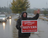 Richard Shivers holds a campaign sign as voters go to the polls in the rain at the Oxford Conference Center in Oxford, Miss. on Tuesday, November 2, 2010.
