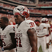 OU linebacker Ogbonnia Okoronkwo, 31, and teammates take the field prior to the game.<br /> <br /> Todd Spoth for The New York Times.