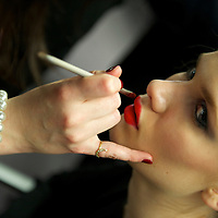 Last minute lipstick is applied before the Temperley autumn 2011 collection at The British Museum in London on 20 February 2011.