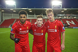 LIVERPOOL, ENGLAND - Tuesday, December 9, 2014: Liverpool's goalscorers Jerome Sinclair, Ryan Kent and Daniel Cleary celebrate making it to the final found of the UEFA Youth League after a 2-0 Group B victory over FC Basel at Langtree Park. (Pic by David Rawcliffe/Propaganda)