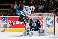 KELOWNA, CANADA - APRIL 17: Cole Linaker #26 of Kelowna Rockets takes a shot on Coleman Vollrath #35 of Victoria Royals as he defends the net during second period on April 17, 2016 at Prospera Place in Kelowna, British Columbia, Canada.  (Photo by Marissa Baecker/Shoot the Breeze)  *** Local Caption *** Cole Linaker; Coleman Vollrath;