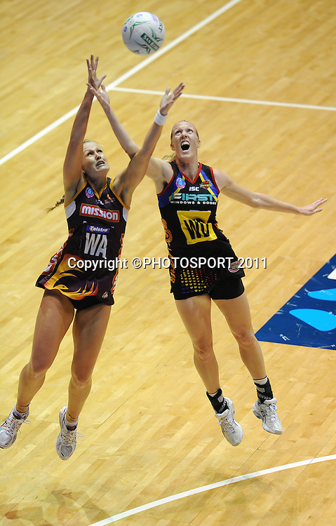 L_R Firebirds wing attack Chelsea Pittman and BOP Magic's Jodi Todd go for the ball.<br /> ANZ Netball Championship, Queensland Firebirds v BOP Magic, Semi Final. Gold Coast Convention Centre, Gold Coast, Australia, Monday 9 May 2011. Photo: Andrew Cornaga/photosport.co.nz