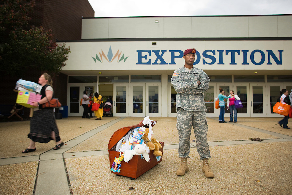 Army First Sergeant Darryl Harris, of the 82nd Airborne, keeps guard of a toy chest won by an expecting mother outside of the Crown Exposition Center in Fayetteville, NC, Sat., Nov. 15, 2008, following the first ever ?Boots And Booties? military baby shower, the largest in the world. Around 1,000 pregnant women or new mothers married to a member of or currently enlisted in the armed services were invited to attend the event organized by the Fayetteville and Cumberland County Area Convention and Visitors Bureau who recently declared the area a sanctuary for military families..