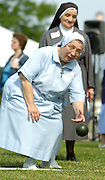 Sr. Ann Josepha Lencioni, a Sister of Charity of St. Joan Antida, tosses a bocce ball during a bocce tournament held during the annual St. Joan Antida High School reunion, held July 22 at the Henry Meier Festival Grounds in Milwaukee. (Photo by Sam Lucero)