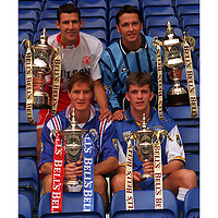 Captains of the four clubs who are favourites to win respective leagues Richard Gough Jim Weir Martin McIntosh and Jim Hamilton holding Bells trophies