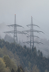 THEMENBILD - Strommasten und Stromleitungen in der nebeligen Waldlandschaft, aufgenommen am 30. April 2019 in Kaprun, Österreich // Power pylons and power lines in the foggy forest landscape, Kaprun, Austria on 2019/04/30. EXPA Pictures © 2019, PhotoCredit: EXPA/ JFK