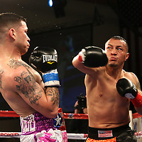 KISSIMMEE, FL - MARCH 06:  Charles Natal (L) trades punches with Juan Aguirre during the Telemundo Boxeo boxing match at the Kissimmee Civic Center on March 6, 2015 in Kissimmee, Florida. (Photo by Alex Menendez/Getty Images) *** Local Caption ***  Charles Natal; Juan Aguirre