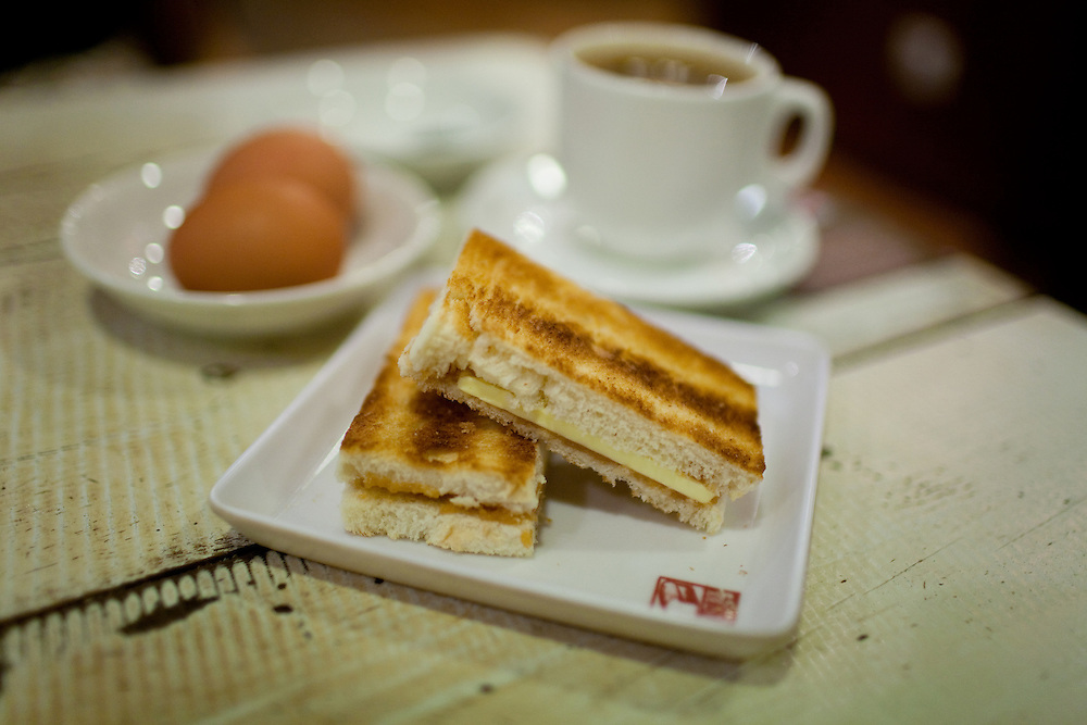 A traditional Chinese Breakfast consist of half boiled eggs, kaya toast and sweet strong coffee. Kaya is a jam made of coconut. yummy!
