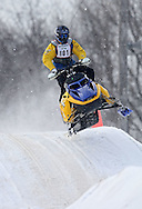 Sam Reicks of Center Point gets some air as a light snow falls at the Frozen Few 1st Inaugural Amateur Sno-X Race held at Hawkeye Downs, 4400 6th Street SW in Cedar Rapids on Saturday January 22, 2011. 1,200 people turned out to watch over 50 racers in 12 divisions at the event sponsored by the Frozen Few Snowmobile Club. A portion of the proceeds went to the Spina Bifida Association of Iowa. The next race is February 19th.