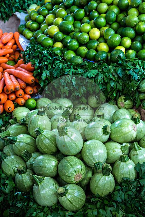 Fresh round zucchini at Benito Juarez market in Oaxaca, Mexico.