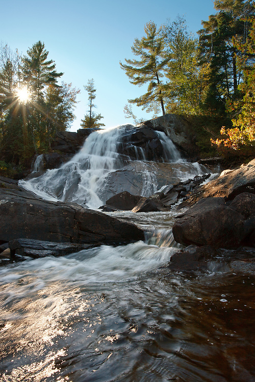 Wide Angle view afternoon sunstar High Falls Waterfall East Side Algonquin Provincial Park Canada