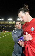 Zlatan Ibrahimovic  of PSG is accosted by a Toulouse ball boy who hassles the player for his shirt at the end of the game . Toulouse v Paris St Germain, Ligue 1, Stade Municipal, Toulouse, France, 1st Feb 2013..Credit - Eoin Mundow/Cleva Media, www.clevamedia.com