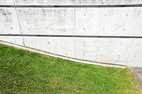 Grass verge next to brick wall