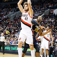 06 December 2013: Portland Trail Blazers center Robin Lopez (42) grabs a rebound during the Portland Trail Blazers 130-98 victory over the Utah Jazz at the Moda Center, Portland, Oregon, USA.
