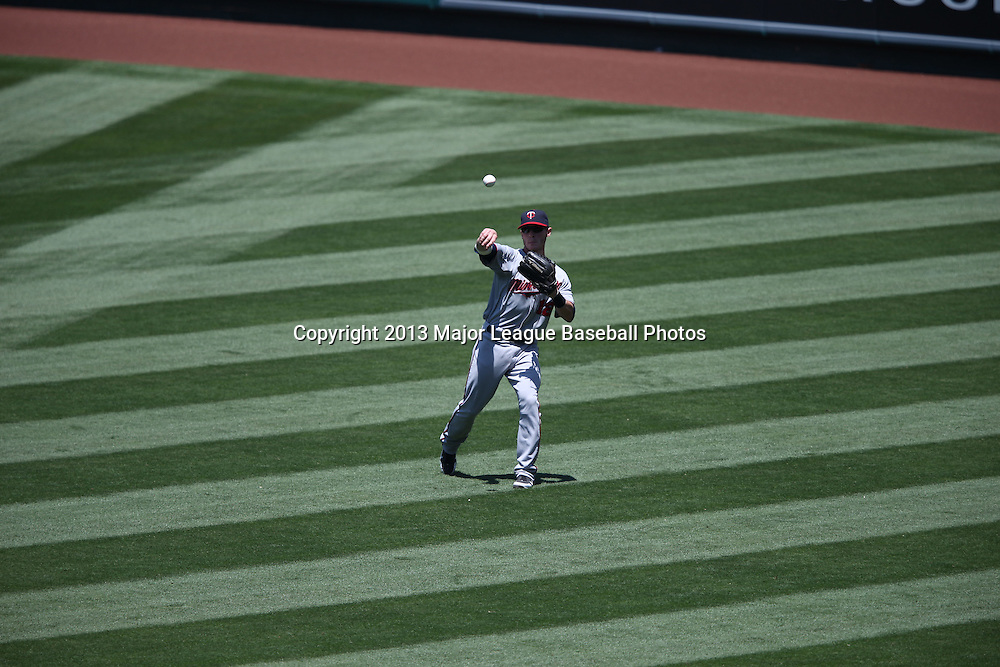 ANAHEIM, CA - JULY 24:  Chris Herrmann #12 of the Minnesota Twins throws the ball back to the infield during the game against the Los Angeles Angels of Anaheim on Wednesday, July 24, 2013 at Angel Stadium in Anaheim, California. The Angels won the game in a 1-0 shutout. (Photo by Paul Spinelli/MLB Photos via Getty Images) *** Local Caption *** Chris Herrmann