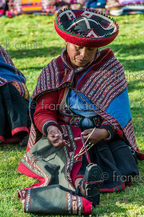 Cuzco, Peru - July 15, 2013: women weaving in the peruvian Andes at Cuzco Peru on july 15th, 2013