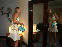 Tennis<br /> Wimbledon 2004<br /> Foto: Fotosports/Digitalsport<br /> NORWAY ONLY<br /> <br /> Maria Sharapova from Russia checks her outfit for the traditional Wimbledon Ball. This is  Sharapova's first Grand Slam victory
