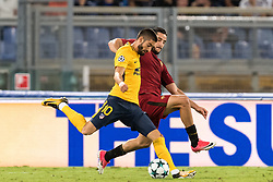 (L-R) Yannick Carrasco of Club Atletico de Madrid, Kostas Manolas of AS Roma during the UEFA Champions League group C match match between AS Roma and Atletico Madrid on September 12, 2017 at the Stadio Olimpico in Rome, Italy.