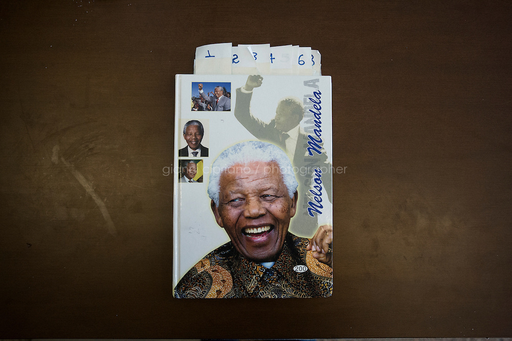 ROME, ITALY - 25 NOVEMBER 2014: A Nelson Mandela notebook is used as a register of the apartment building in the former headquarters of ISPRA (Institute for Environmental Protection and Research) that since November 2013 is squatted by approximantely 600 Eritrean refugees and asylum seekers,  in Rome, Italy, on November 25th 2014.