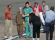HOUSTON - September 1: Medical personnel help transport patients airlifted from the New Orleans VA Hospital to Ellington Field in Houston, Thursday, Sept. 1, 2005. Twenty five patients and several medical personnel were airlifted by members of the Tennessee Air National Guard.<br />
