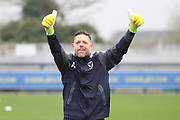 AFC Wimbledon goalkeeping coach Ashley Bayes warming up during the EFL Sky Bet League 1 match between AFC Wimbledon and Charlton Athletic at the Cherry Red Records Stadium, Kingston, England on 10 April 2018. Picture by Matthew Redman.