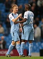 Photo: Paul Thomas.<br /> Manchester City v Middlesbrough. The Barclays Premiership. 30/10/2006.<br /> <br /> Man City player Ben Thacther (L) is congratulated after the game by team mate Hatem Trabelsi. This was Thacther's first game back after an 8 game ban.