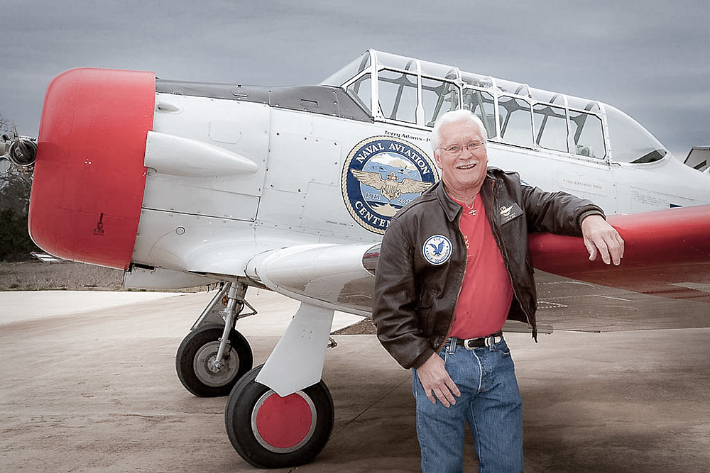 Retired Naval aviator with his restored T-6
