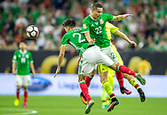 Mexico's Paul Aguilar, right, collides with team mate Jesus Molina during a Copa America Centenario game against Venezuela at NRG Stadium in Houston, Texas on Monday June 13, 2016.