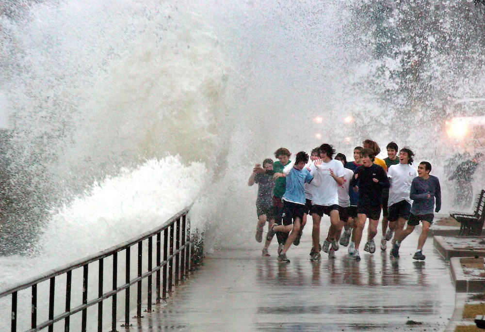 Gloucester: Members of the Gloucester High School track team get caught in a wave coming over the railing on Stacy Boulevard Wednesday afternoon. High winds in the area caused wild conditions like this along the Boulevard. Winds were recorded as high as 80 miles per hour in the Boston area. The wind caused some powere outages with as many as 10,000 people on the North Shore without powere at some point in the afternoon..Photo by Mike Dean/Gloucester Daily Times Wednesday, January 18, 2006