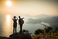 Fethiye, Turkey, October 2015.  Hikers on the Likya Yolu between Ovacik, Faralya and Kabak, overlooking the blue lagoon of Olu Deniz. The Lycian Way is a 540 km, 29-day way-marked footpath around the coast of Lycia in southern Turkey, from Fethiye to Antalya. The trail consists mainly of Roman roads, old footpaths and mule trails, often hard and stony underfoot, not suitable for mountain bikes. Lying between the coast and mountains, it often has steep gradients. Photo by Frits Meyst / MeystPhoto.com
